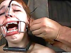 Tied up gal receives tongue and facial punishment