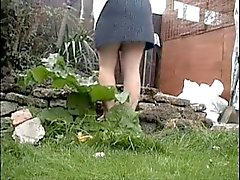 Spying my mom working in the garden. She dont wear panty