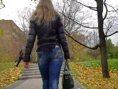 Nice blonde with small round ass in jeans at autumn day