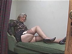 Busty granny in stockings shows off plump cameltoe and hairy pussy
