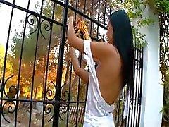 Charming lesbians fingering in a garden