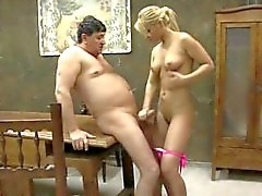 Young beautiful blonde with an old man