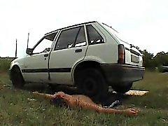 slave crushed under mistress car