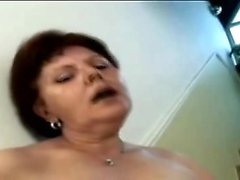 Redhead mature bitch takes on fat cock