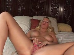 Long dildo makes a babe moan