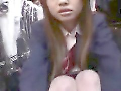 Delightful Asian schoolgirl reveals her naughty side in a p