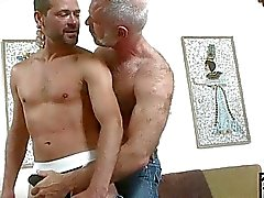 Older gay hunk gets to play with younger hard cum shooter