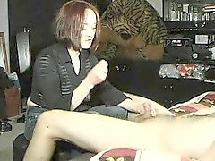 Classy redhead lady in a black shirt displays her nice hand