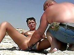 Shameless amateur fisted on a public beach