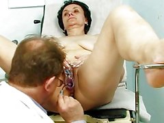 Old brunette granny gets her old twat examined by kinky doctor