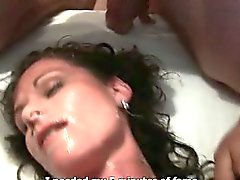 Hot brunette bitch gets her face jizzed
