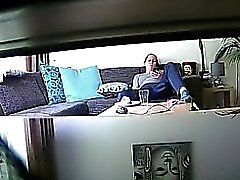 Peeping tom uses a hidden cam to spy on a brunette lounging