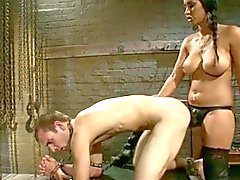 Mistress fucks him with strapon