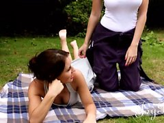 Two stunning girls are having a picknick and spice things
