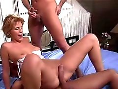 Tight pussy takes in two pulsating members
