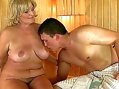 Busty grandma fucking with young man